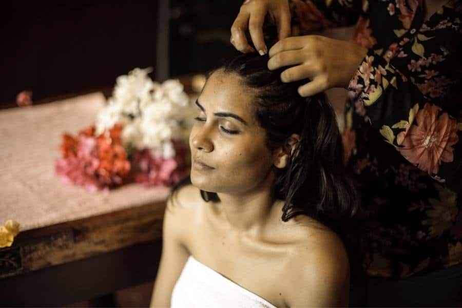 woman using shea butter in hair overnight