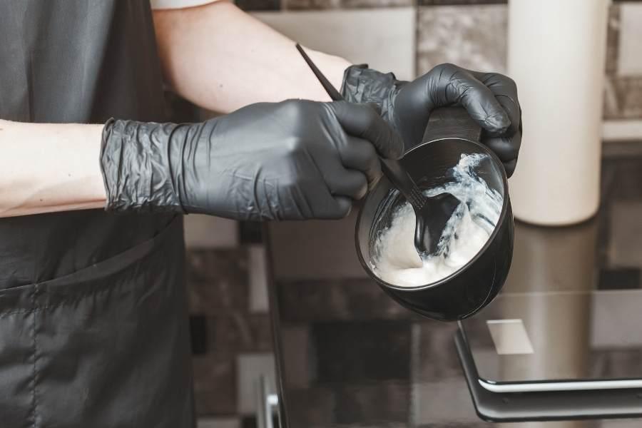 person mixing home hair dye kit